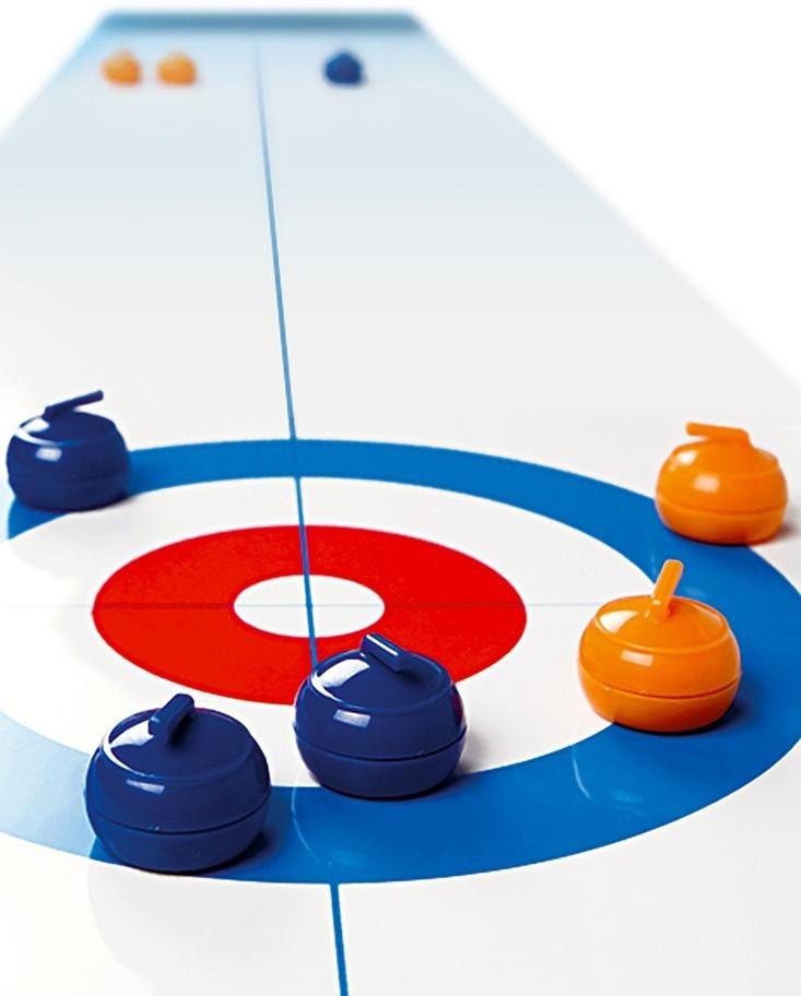 Le curling de table ou la glisse en chambre